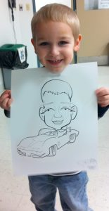 Little boy with car drawing
