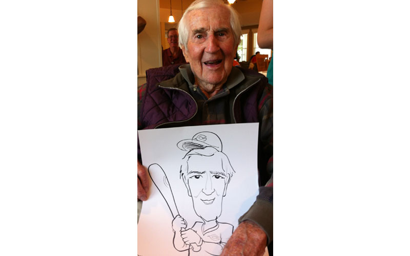 Baseball champ caricature at party