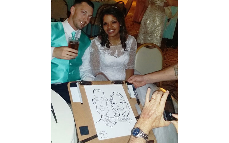 People having live caricatures drawn at wedding