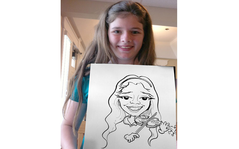 Little Girl caricature at party with drawing from caricature artist.