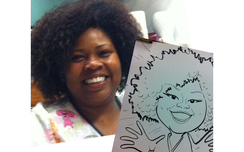 Lady at party with caricature from caricature artist.